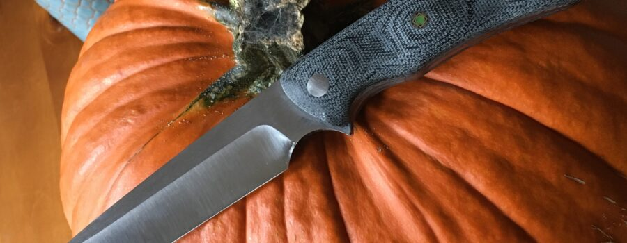 Camp knife made with 1/4 inch CPM154 stainless and canvas Micarta